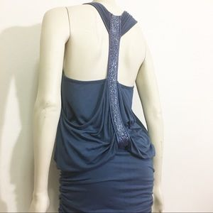 Akiko cotton dress with beaded detail on the back.
